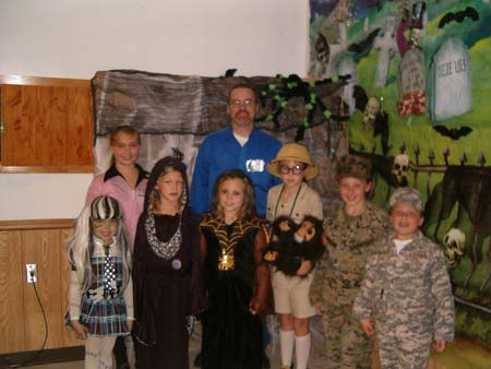 Clarion County Commissioner Candidate Wayne Brosius poses with children at a Halloween party in West Freedom. Wayne, along with his wife and his mother, served as judges of Halloween costumes at the event.