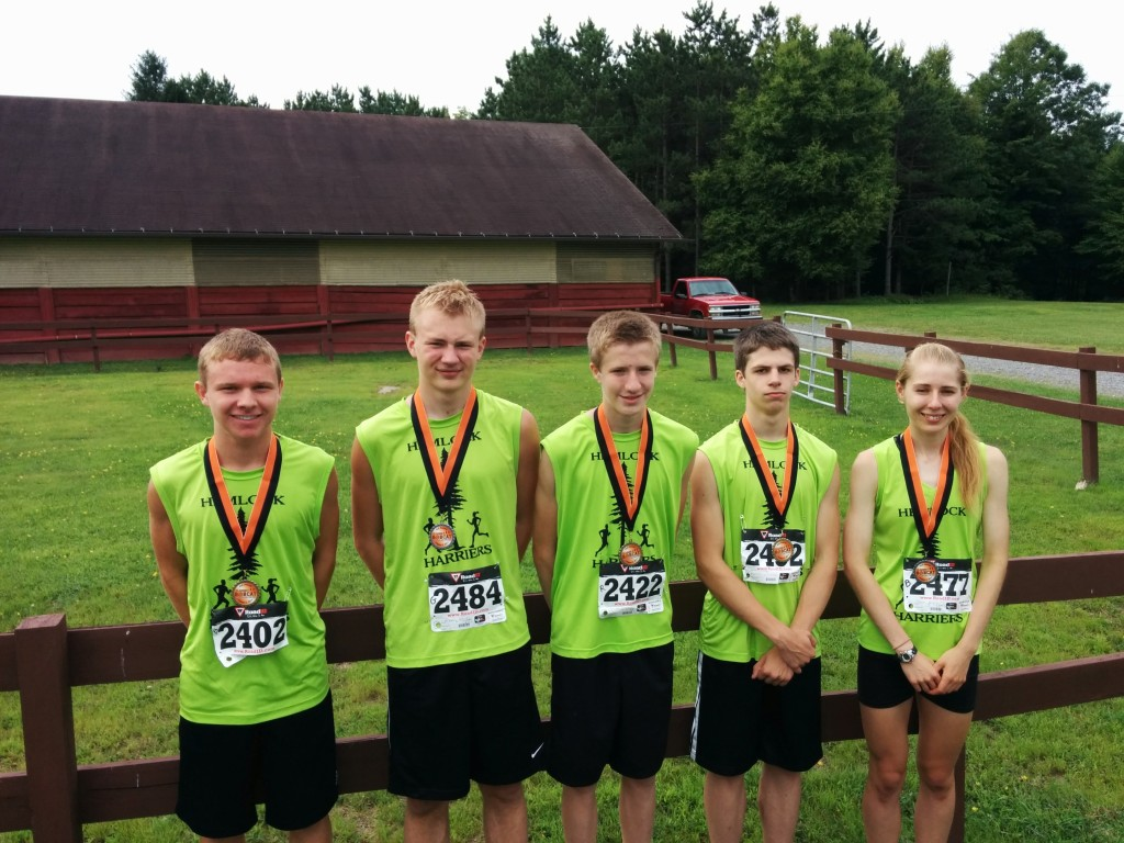 """""""The Hemlock Harriers raced to victory at the Bobcat 5K run at Clarion County Park on August 2. The group has over 25 members and meets several times a week to train in Cook Forest State Park and 'Rail 66' in Lucinda. It is comprised of runners of all ages and abilities and includes cross country runners from both Clarion Area & North Clarion High Schools. The group of runners is organized by Scott and Patti Delaney and Rod and Kara Raehsler.  Shown in Photo: (Left to Right) Adam Bettwy - medalist; Isaiah Griebel- medalist; Race Winner: Liam Raehsler(Center of photo); Isaac Kaye - medalist; and Kayce Bobnar- 2nd female."""" Submitted by Scott Delaney,"""