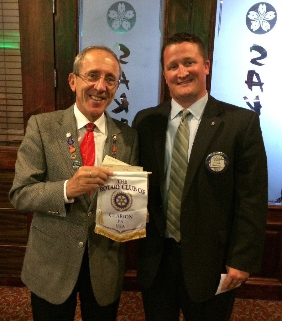 """Rotary District Governor Ruzhidi """"Rudy"""" Bakali of Warren visited and exchanged club flags with Clarion Rotary President Casey O'Toole.  Bakali has a distinguished record in Rotary, also serving as a club president in Kosovo.  Photo by Ron Wilshire."""