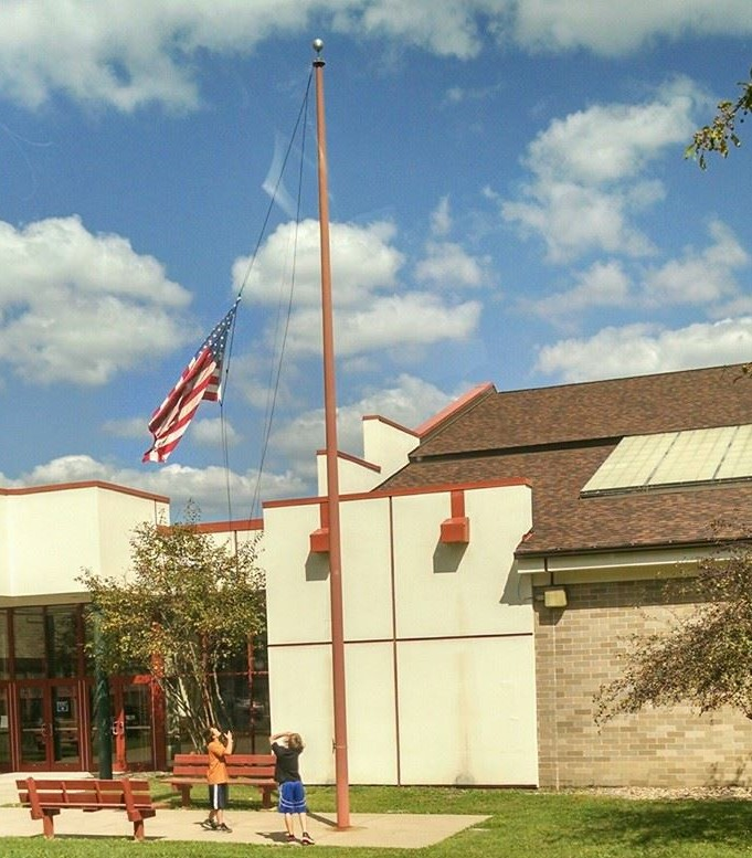 """AC Valley 6th graders, Morgan Cope (left) and Ethan McFadden, lowering and folding the flag at AC Valley Elementary before the end of school today (9/8/2014)."" Photo submitted by Eric McFadden"