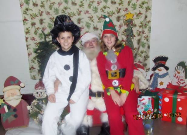 Ron Beichner with his two elves, Zac and Jadyn, at Fryburg's Light Up Night Celebration. Photo courtesy of The Washington House.