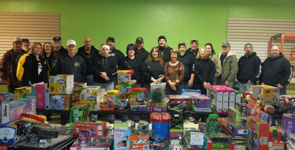 """""""Members of Clarion County ABATE (Alliance of Bikers Aimed Towards Education) delivered almost $10,000 in toys and bicycles to John Kerle of Charitable Deeds and Services for distribution to children in need in the community.""""   Submitted by Shelly Kaltenbach."""