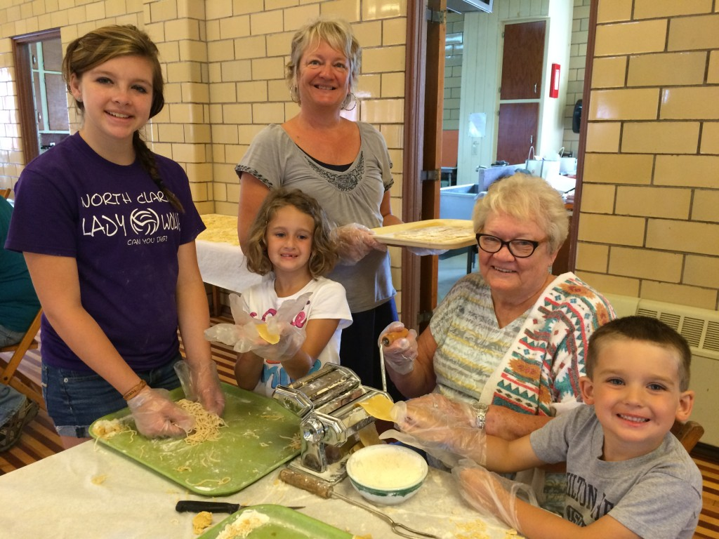 Noodle Days….Fourth generation noodle-makers help great-grandmother Peg Wolbert of Lucinda and a team of volunteers turn 400 lbs. of flour and 180 dozen eggs over 2  days into homemade noodles for St. Joseph's 76th Annual 4th of July Celebration.  The church makes enough noodles to fill the social twice.