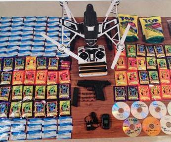 Police-Men-plotted-to-use-drone-to-smuggle-drugs-gun-porn-into-prison[1]